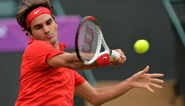 Switzerland's Roger Federer returns the